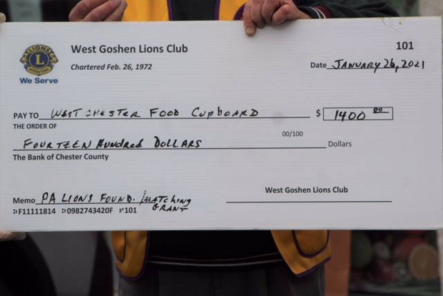 West Goshen Lions Club delivers the Lions of PA. Foundation Matching Check for $1,400 to the WC Food Cupboard. Anna Taylor- West Chester Board member; President of WG Lions -Anthony Simkovich, 14P Zone Chairman Toby Gelman